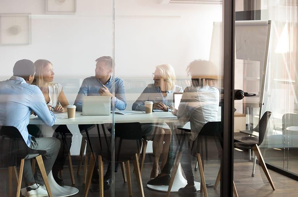 department brainstorming at modern office boardroom behind closed doors